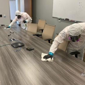 cleaning crew wiping down desk